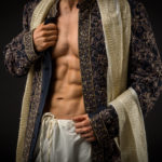 A male fitness model in a hand-crafter traditional Indian garment